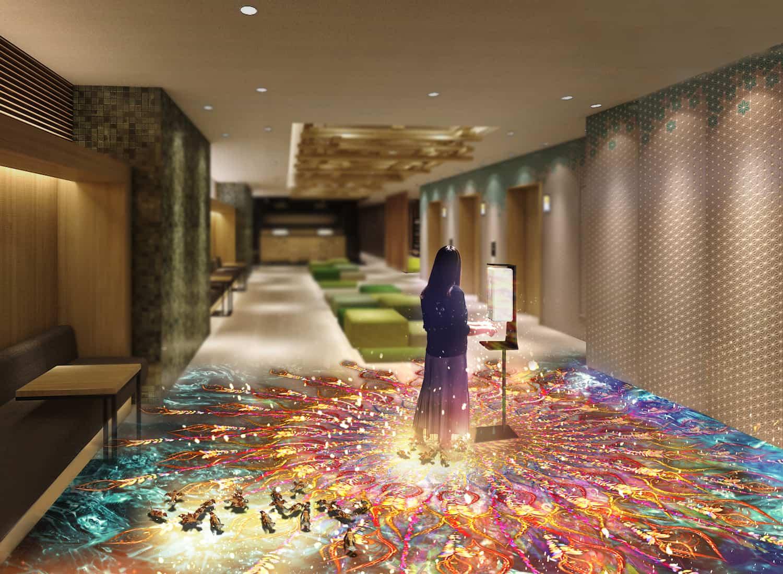 お客様が手指をアルコール消毒すると同時に床一面に鳳凰が舞い、神秘的な空間に早変わり